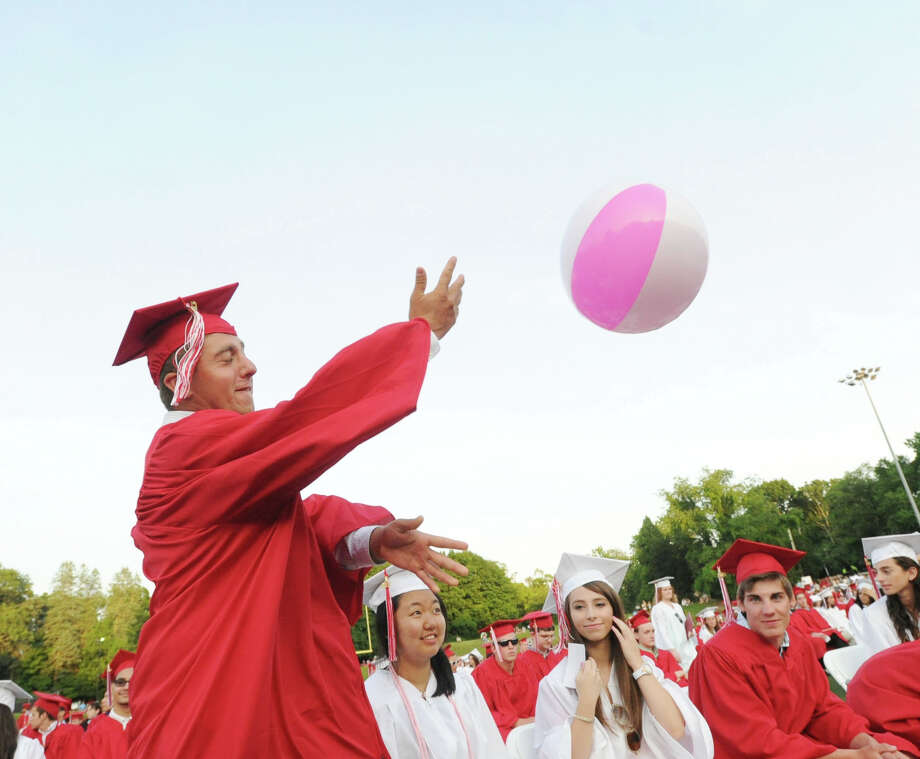 Graduating senior Samuel Latto hits a beach ball in the air during the Greenwich High School graduation ceremony at Cardinal Stadium, Friday evening, June 21, 2013. Photo: Bob Luckey / Greenwich Time