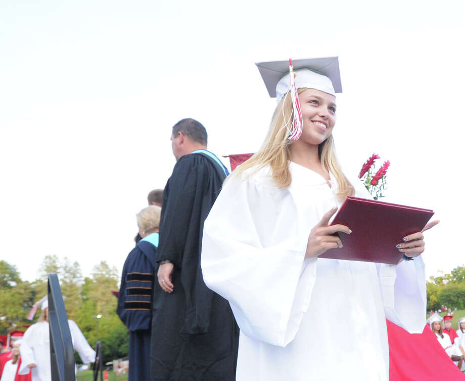 Connie Bowman smiles after receiving her diploma during the Greenwich High School graduation ceremony at Cardinal Stadium, Friday evening, June 21, 2013. Photo: Bob Luckey / Greenwich Time