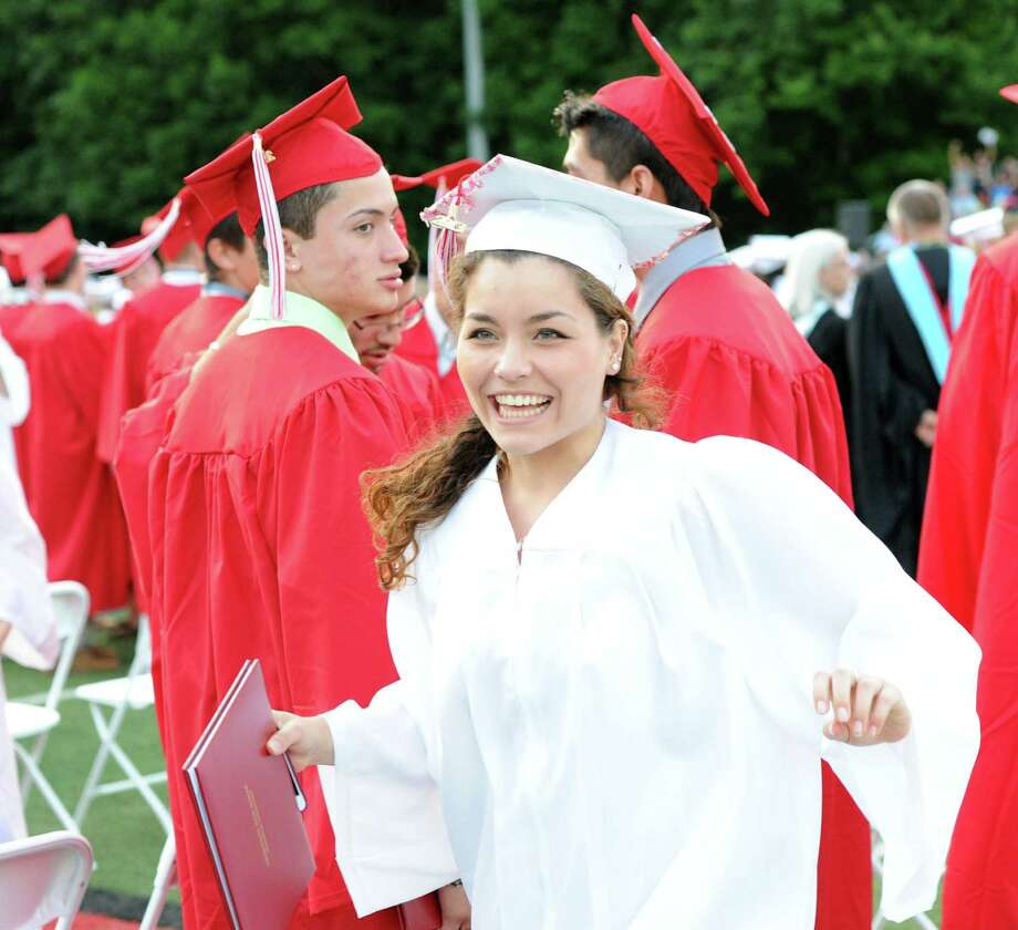 Graduating senior Maya Edward rejoices during the Greenwich High School graduation ceremony at Cardinal Stadium, Friday evening, June 21, 2013. Photo: Bob Luckey / Greenwich Time