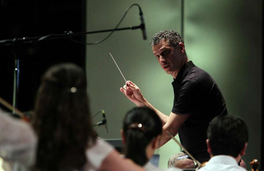 Robert Franz, Associate Conductor, leads the orchestra during the Houston Symphony 100th birthday concert at Miller Outdoor Theater on Friday, June 21, 2013, in Houston. Photo: Mayra Beltran / © 2013 Houston Chronicle