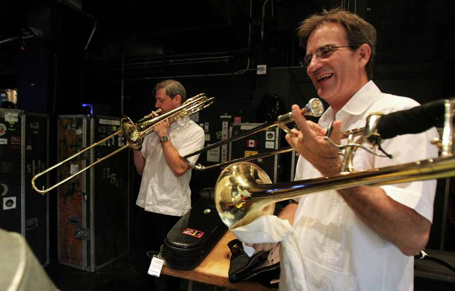 Phillip Freeman and Allen Barnhill, Principal Trombone, warm-up before the Houston Symphony 100th birthday concert at Miller Outdoor Theater on Friday, June 21, 2013, in Houston. Photo: Mayra Beltran / © 2013 Houston Chronicle
