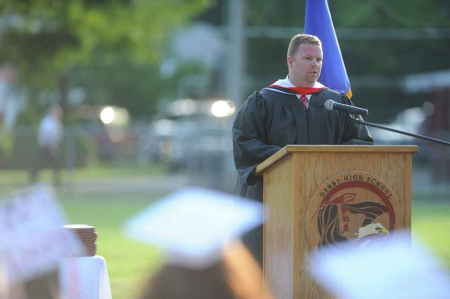 Principal Gregory Gaillard speaks during the Derby High School commencement ceremony Friday, June 21, 2013 on the football field. Photo: Autumn Driscoll / Connecticut Post