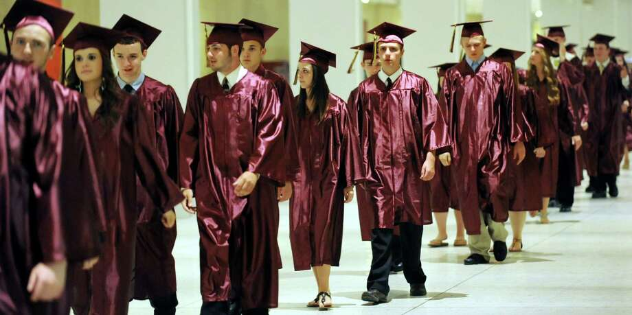 Graduates file in for the South Colonie High commencement exercises on Friday, June 21, 2013, at the Convention Center in Albany, N.Y. (Cindy Schultz / Times Union) Photo: Cindy Schultz / 10022844A