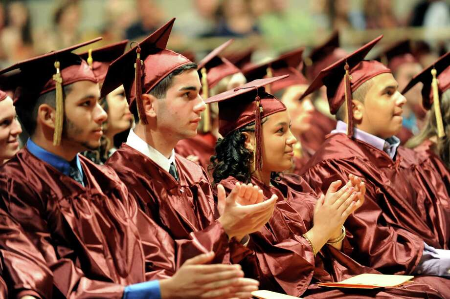 Graduates applaud speakers during the South Colonie High commencement exercises on Friday, June 21, 2013, at the Convention Center in Albany, N.Y. (Cindy Schultz / Times Union) Photo: Cindy Schultz / 10022844A