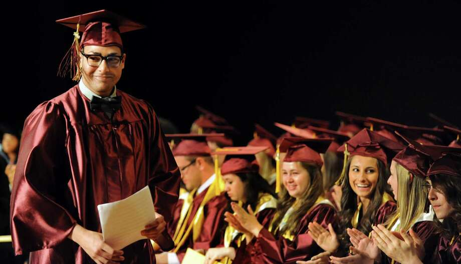 Graduate Zachary Hart, left, delivers the senior speech during the South Colonie High commencement exercises on Friday, June 21, 2013, at the Convention Center in Albany, N.Y. (Cindy Schultz / Times Union) Photo: Cindy Schultz / 10022844A