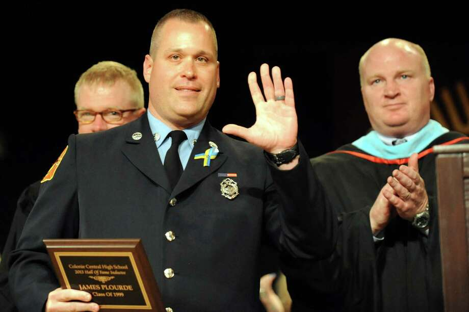 James Plourde, Class of 1999, center, is inducted into the school hall of fame for his rescue efforts during the Boston Marathon Bombing at the South Colonie High commencement exercises on Friday, June 21, 2013, at the Convention Center in Albany, N.Y. (Cindy Schultz / Times Union) Photo: Cindy Schultz / 10022844A