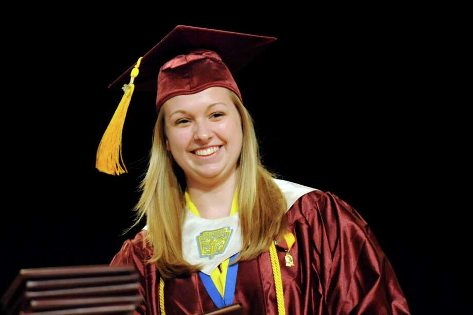Graduate Courtney Benoit receives her diploma during the South Colonie High commencement exercises on Friday, June 21, 2013, at the Convention Center in Albany, N.Y. (Cindy Schultz / Times Union) Photo: Cindy Schultz / 10022844A