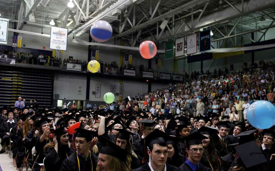 Bethlehem Central High School graduating students toss beach balls as they approach the end of the commencement ceremony held at the University at Albany SEFCU Arena on Friday June 21, 2013 in Albany, N.Y. (Dan Little/Special to the Times Union) Photo: Dan Little / Copyright: All Rights Reserved Dan Little