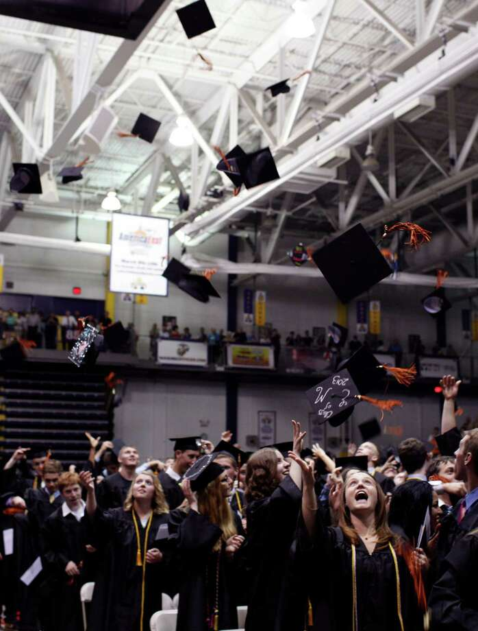 Bethlehem Central High School graduating students toss their caps in the air at the close of the commencement ceremony held at the University at Albany SEFCU Arena on Friday June 21, 2013 in Albany, N.Y. (Dan Little/Special to the Times Union) Photo: Dan Little / Copyright: All Rights Reserved Dan Little