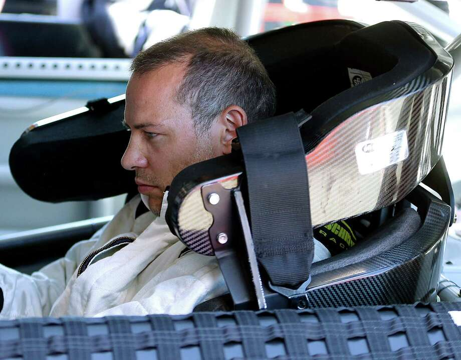 Jacques Villeneuve, of Canada, prepares to take practice laps for the NASCAR Sprint Cup Series auto race on Friday, June 21, 2013, in Sonoma, Calif. (AP Photo/Ben Margot) Photo: Ben Margot