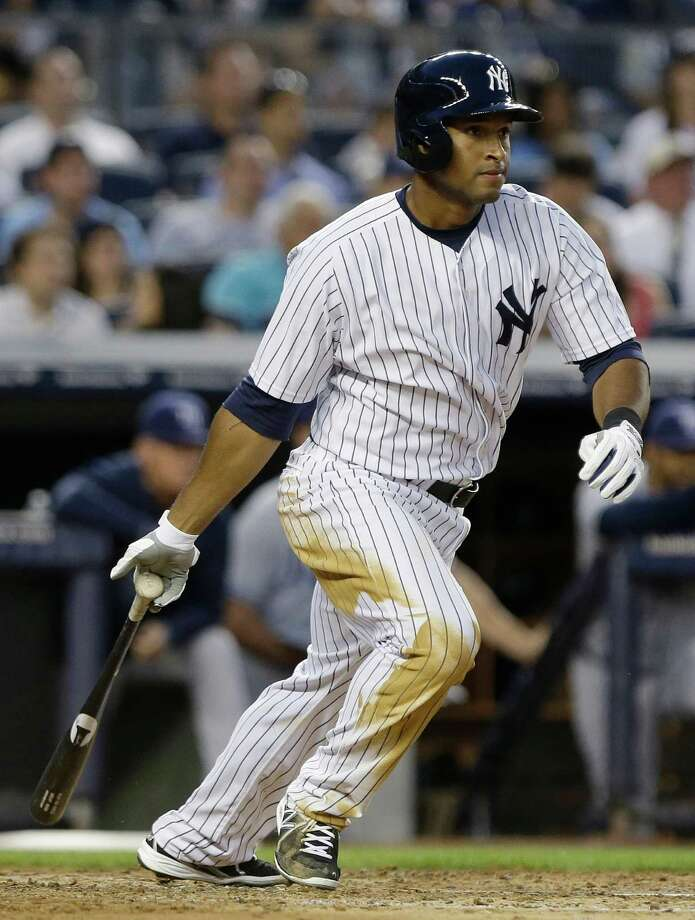 New York Yankees' Zoilo Almonte hits a single during the fourth inning of a baseball game against the Tampa Bay Rays, Friday, June 21, 2013, in New York. (AP Photo/Frank Franklin II) Photo: Frank Franklin II
