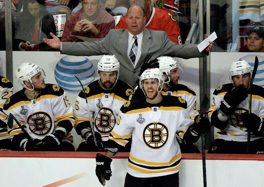 Bruins coach Claude Julien, above, and Blackhawks counterpart Joel Quenneville have turned an array of adjustments and tweaks into pivotal wins in the series. Photo: Harry How, Staff / 2013 Getty Images