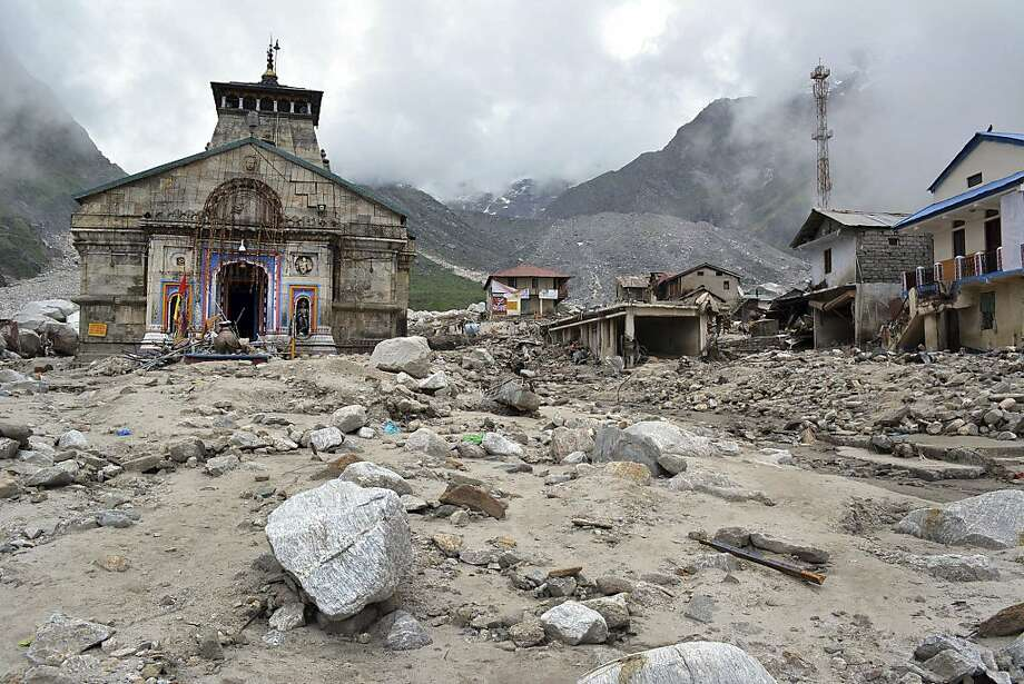 In this Thursday June 20, 2013 photo, the Kedarnath shrine, one of the holiest of Hindu temples dedicated to Lord Shiva, and other buildings around it are seen damaged following monsoon rains in at Kedarnath  in the northern Indian state of Uttrakhand. A joint army and air force operation are trying to evacuate thousands of people stranded in the upper reaches of the state of Uttrakhand where days of rain had earlier washed out houses, temples, hotels and vehicles leading to deaths of over a hundred people amid fears that the death toll may rise much higher. (AP Photo) Photo: Associated Press