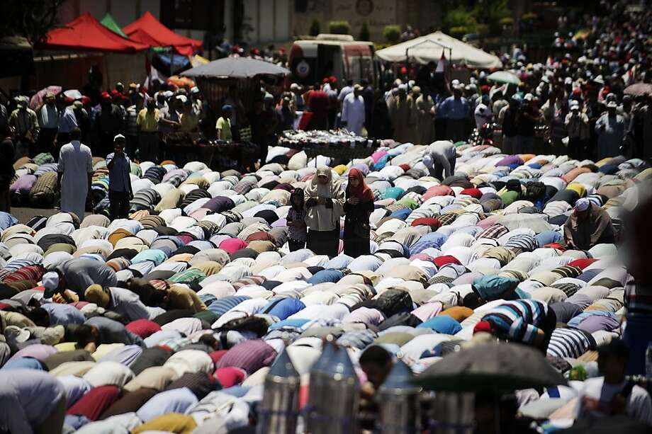 Egyptian Islamist groups led by the ruling Muslim Brotherhood take part in a demonstration to mark the upcoming one year anniversary since President Mohamed Morsi was elected, on June 21, 2013 in Cairo. Tens of thousands of Egyptian Islamists gathered for a show of strength in Cairo ahead of planned opposition protests against President Mohamed Morsi, highlighting the tense political divide in the Arab world's most populous state. Morsi was elected after a military-led transition that followed the ouster of long-time president Mubarak in a 2011 popular uprising. AFP PHOTO/GIANLUIGI GUERCIAGIANLUIGI GUERCIA/AFP/Getty Images Photo: Gianluigi Guercia, AFP/Getty Images