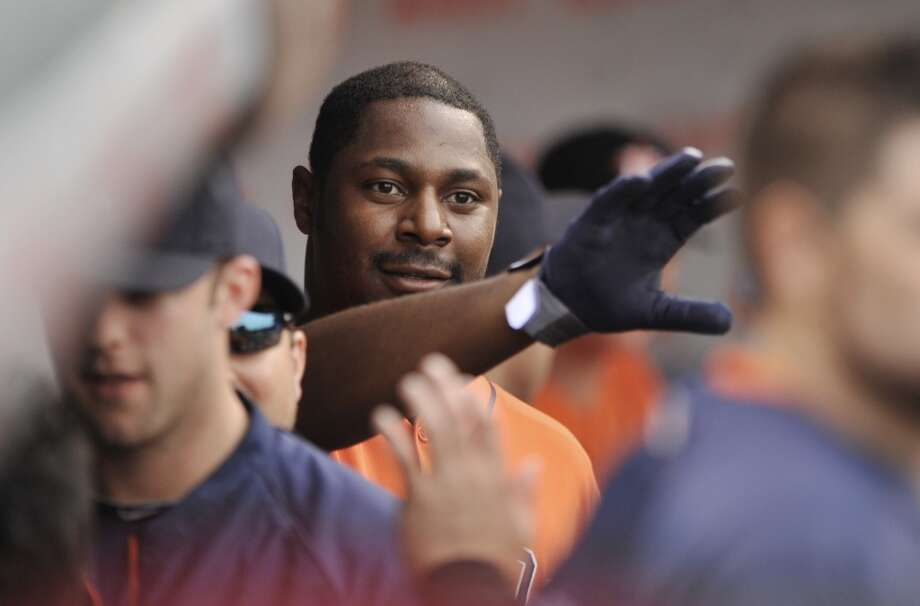 Chris Carter celebrates with teammates in the dugout after hitting a solo home run in the seventh inning.