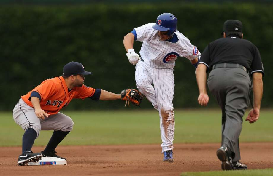Darwin Barney is tagged out trying to steal second base by Jose Altuve.
