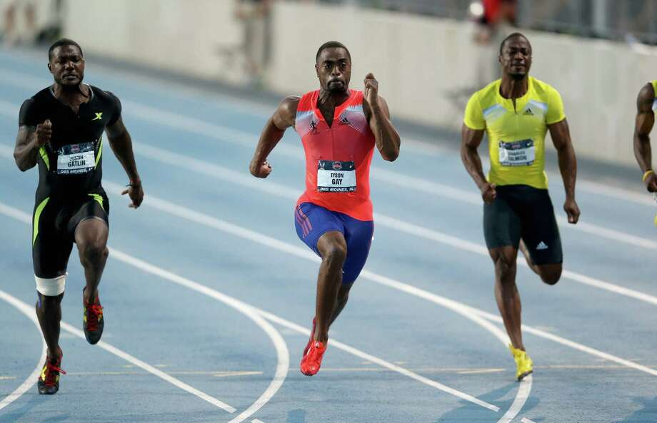 Tyson Gay, center, beats Justin Gatlin, left, and Charles Silmon to the finish line Friday to win the 100 meters at the U.S. outdoor track and field championships in Des Moines, Iowa. Photo: Andy Lyons, Staff / 2013 Getty Images