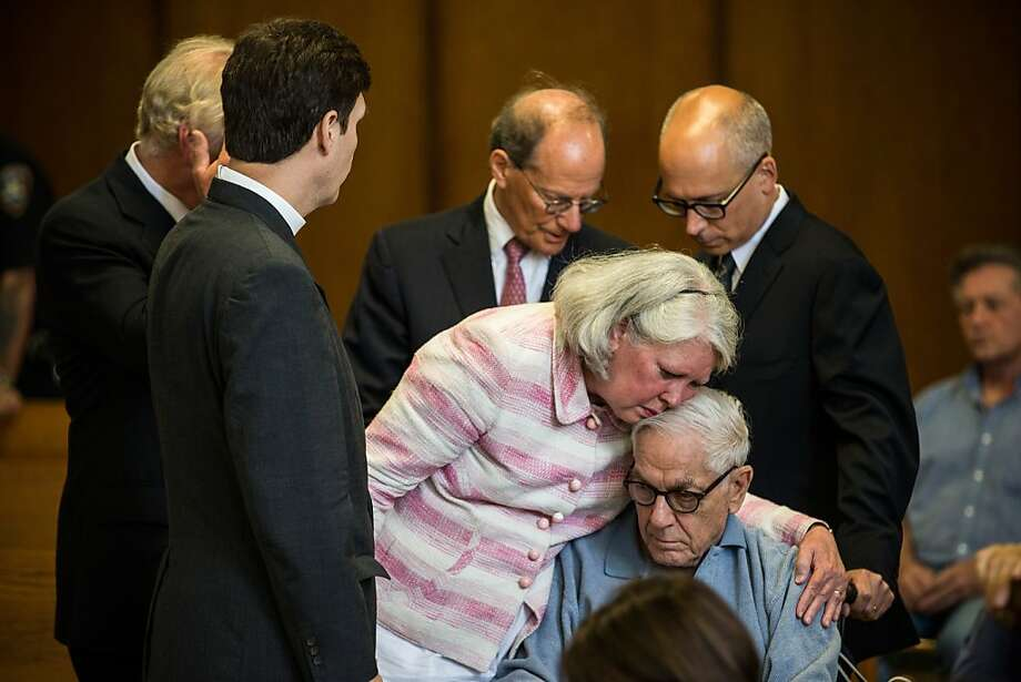 NEW YORK, NY - JUNE 21:  Charlene Marshall, wife of Anthony Marshall, cries on her husband's shoulder before his sentencing at Manhattan Criminal Courts on June 21, 2013 in New York City. Anthony Marshall, age 89 and son of Brooke Astor, was found guilty of stealing millions from his mother's estate, and has been sentenced to serve one year of his three year term.  (Photo by Andrew Burton/Getty Images) Photo: Andrew Burton, Getty Images