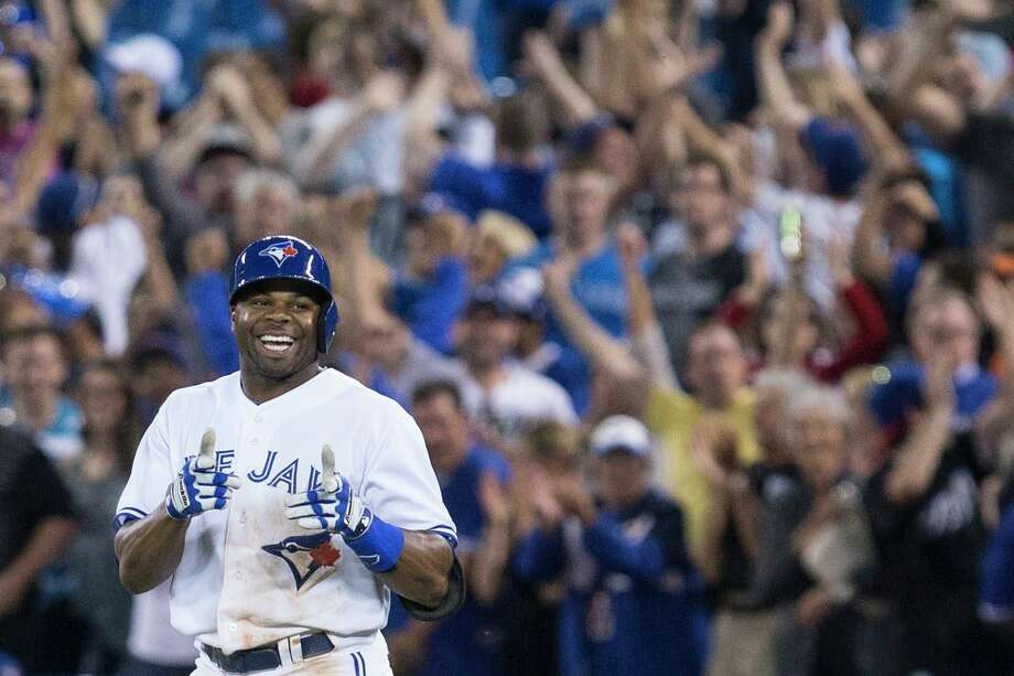 Blue Jays outfielder Rajai Davis was all smiles after delivering the game-winning hit in Friday night's come-from-behind victory over the Orioles. Photo: Chris Young, SUB / The Canadian Press