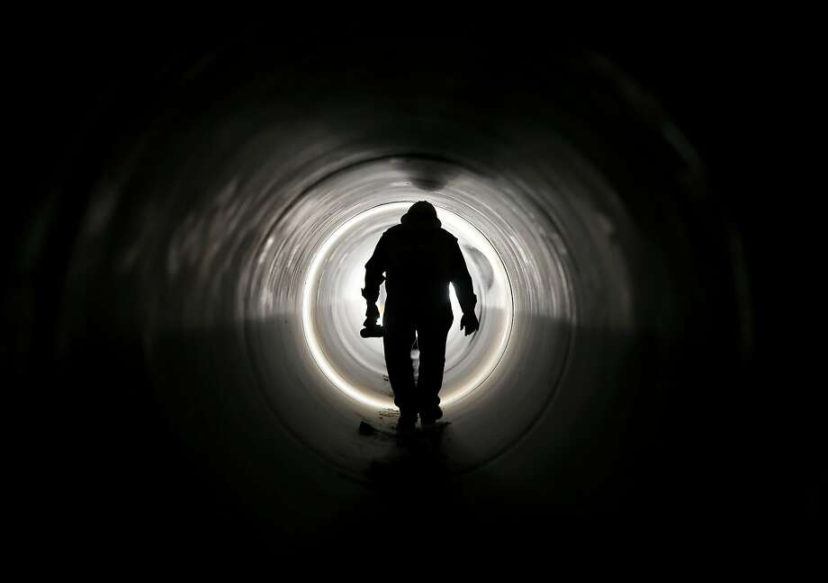 A silhouette of project manager Cort Lambson is seen as he walks in a 60 inch pipe at the North Shore Terminal Reservoir, part of Central Utah Water Conservancy District's CWP project, in Saratoga Springs, Utah, U.S., on Friday, June 20, 2013. The CUWCD Water Development Project (CWP) will develop new infrastructure and water sources to utilize approximately 65,000 acre-feet of surface and ground water rights. Photographer: George Frey/Bloomberg Photo: George Frey, Bloomberg