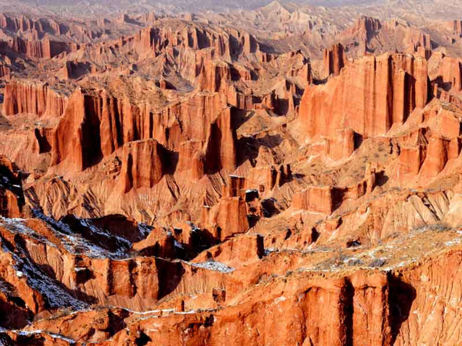 Xinjiang Tianshan's red bed canyons are among the 'unique physical geographic features and scenically beautiful areas' that earned this mountain region a UNESCO World Heritage Site inscription. Photo: Leading Group For Application Of WNH Of Xianjiang Uygur Autonomous Region