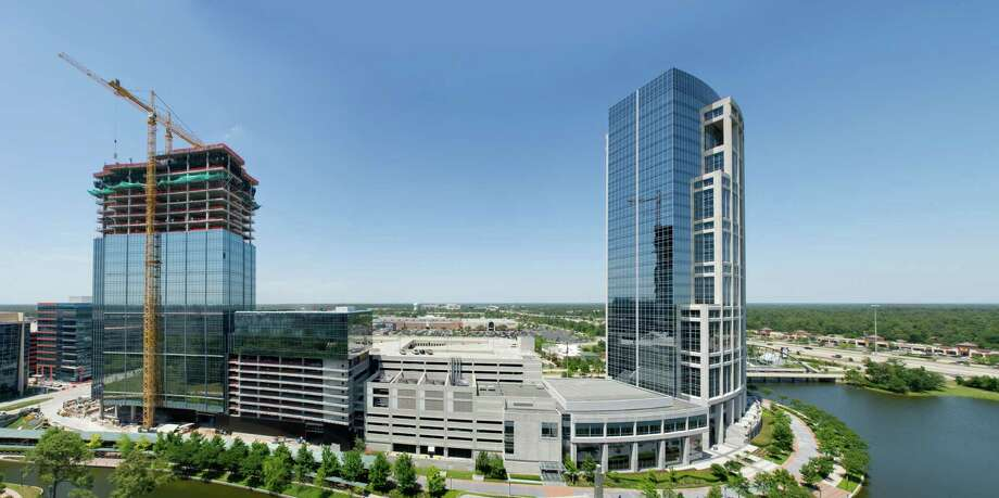 A May 2013 photo of Anadarko Petroleum Corp.'s campus in The Woodlands shows the progress of the 31-story Hackett Tower. It will be connected to the 30-story Allison Tower, completed in 2002. Photo: Courtesy Photo