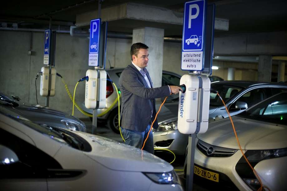 No. 3 -- Netherlands, $8.95/gallon  The Netherlands has the most bicycles per capita in the world. The bike-pedaling Dutch have the highest fuel tax in the European Union.  [Photo: Patrick Langevoort charges his electric car at his workplace in Arnhem, Netherlands.] Photo: ILVY NJIOKIKTJIEN, NYT