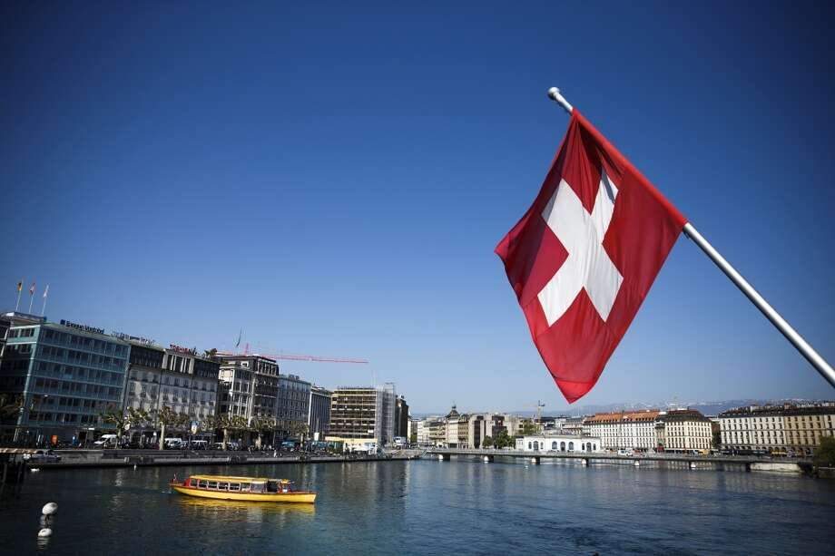 No. 20 -- Switzerland, $7.26/gallon  Switzerland ranks 11th in the amount of gasoline consumed per person. Despite that indulgence, the Swiss maintain some green credentials. Investments in hydroelectric, nuclear and wind power leave them with a carbon dioxide emissions rate that's less than half the average of OECD nations. [Photo: A Swiss national flag flies from a flagpole above Lake Geneva in Geneva, Switzerland.] Photo: Valentin Flauraud, Bloomberg