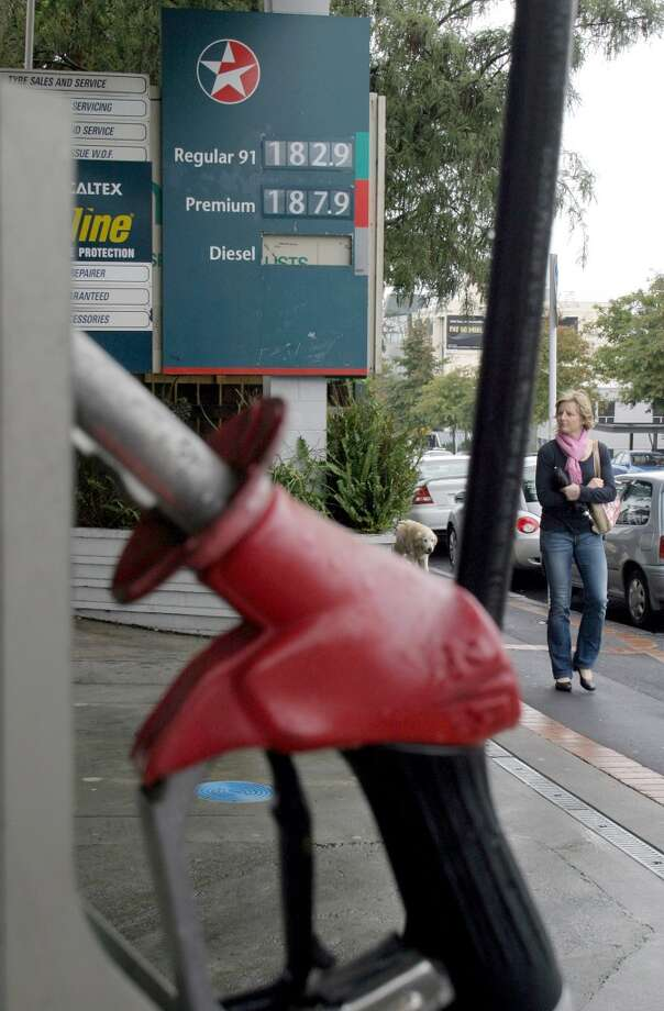 No. 30 -- New Zealand, $6.69/gallon  New Zealand consumes about twice the gasoline per person as the ranking's average of a quarter gallon a day. It has the fourth-highest rate of car ownership, with 712 cars for every 1,000 people, according to the World Bank.  [Photo: A pedestrian walks past a gas station in Auckland, New Zealand.] Photo: STATON WINTER, BLOOMBERG NEWS