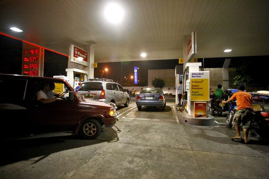 No. 43 -- Philippines, $4.89/gallon  Filipino's pain at the pump is partly offset by an unconventional energy resource available to their economy. The country is the world's second-biggest producer of geothermal energy after the U.S., according to the International Geothermal Association. The nation of 95 million people and 7,100 islands uses this natural resource for about 17 percent of its energy needs.  [Photo: Motorists fill up at a gas station in Manila, the Philippines.] Photo: NANA BUXANI, BLOOMBERG NEWS