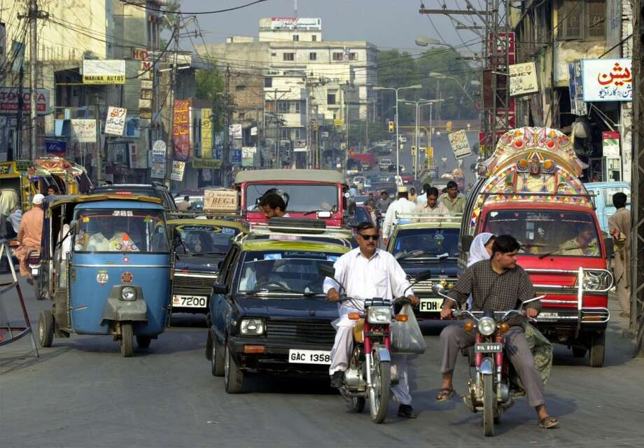 No. 48 -- Pakistan, $3.95/gallon  Instead of gasoline, most Pakistanis opt for cheaper and cleaner compressed natural gas. CNG fuels about 89 percent of the nation's auto fleet. Pakistan has about 3.1 million CNG vehicles on the road, the most of any country, according to NGV Global, a trade group for natural gas vehicle companies.  [Photo: Traffic crowds a street in Rawalpindi, Pakistan.] Photo: EDWARD A. ORNELAS, SAN ANTONIO EXPRESS-NEWS