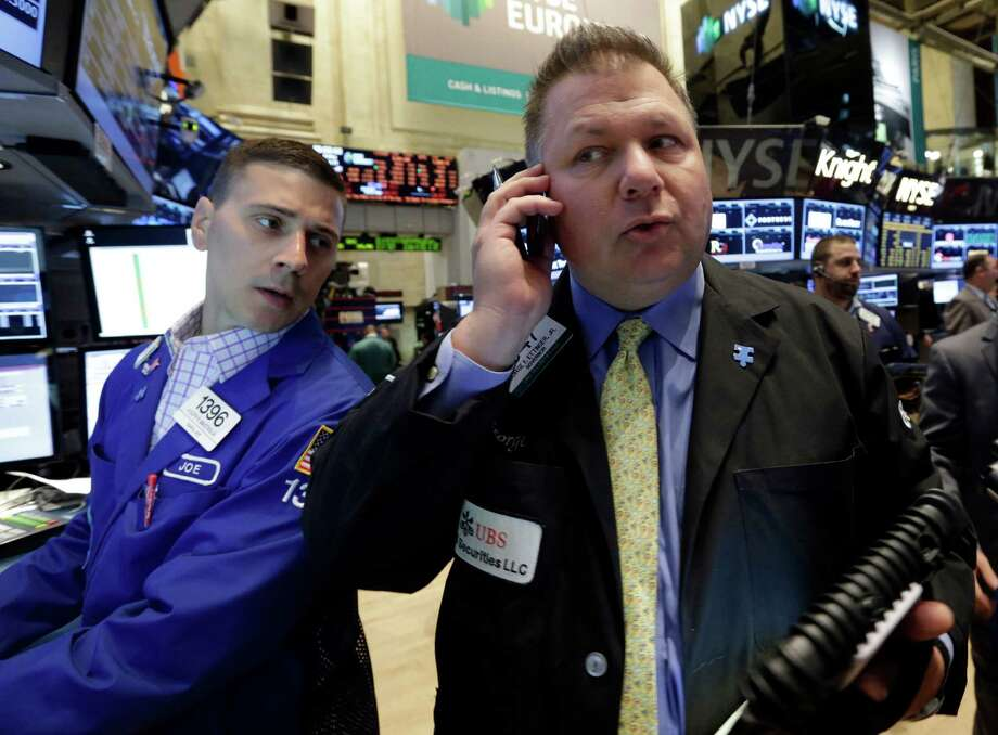 Specialist Joseph Mastrolia, left, and trader George Ettinger work on the floor of the New York Stock Exchange, Friday, June 21, 2013. U.S. stocks rose in morning trading on Friday as traders regrouped following the biggest drop of the year. (AP Photo/Richard Drew) Photo: Richard Drew