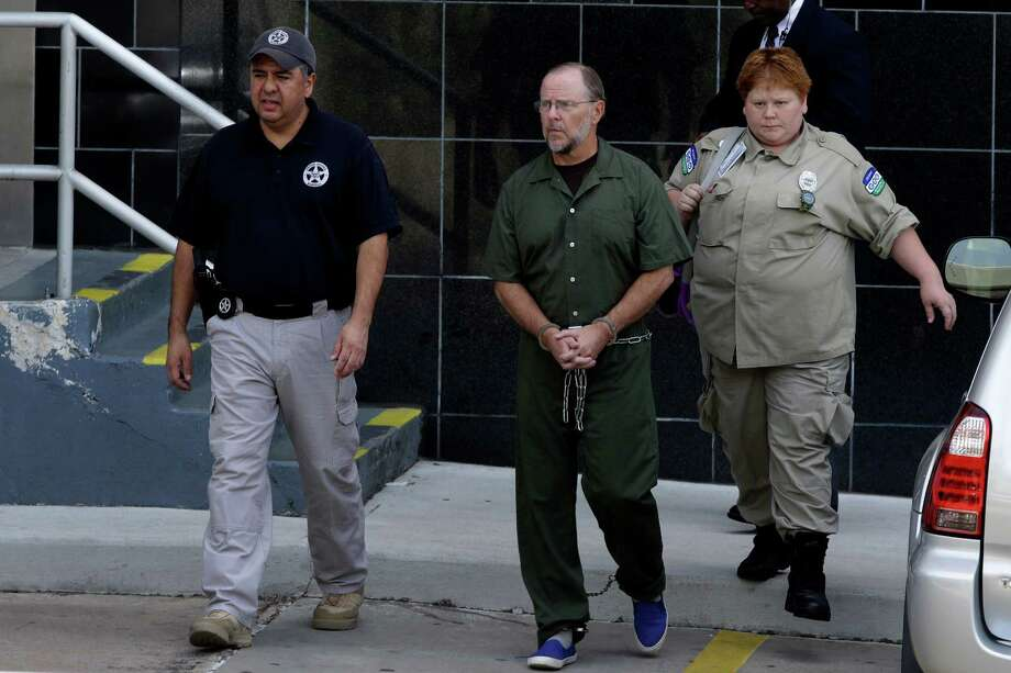 Former Enron CEO Jeffrey Skilling is escorted from the federal courthouse Friday, June 21, 2013, in Houston after  being re-sentenced for his role in the energy giants' collapse.  Skilling was resentenced to 14 years as part of a court-ordered reduction and a separate agreement with prosecutors. The decision brought a protracted legal conclusion to one of the most notorious U.S. financial scandals. Skilling has been in prison since 2006, when he was sentenced to more than 24 years by U.S. District Judge Sim Lake. But an appeals court vacated his prison term in 2009, ruling that a sentencing guideline was improperly applied. That meant a reduction of as much as nine years. (AP Photo/Pat Sullivan) Photo: Pat Sullivan