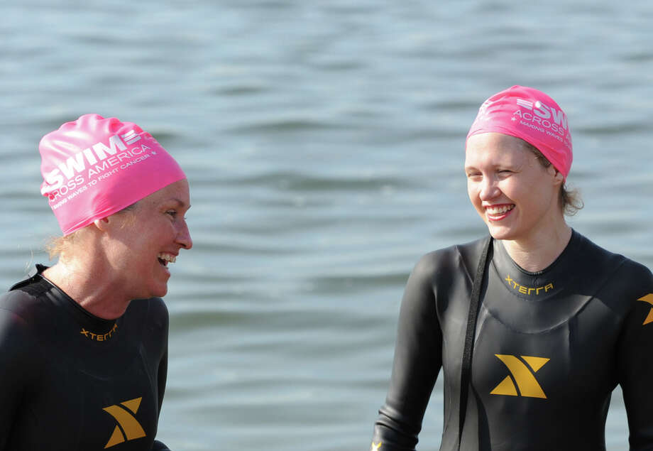 Greenwich residents, Carolyn Driscoll, left, and Elizabeth Leykum, during the Swim Across America event for the Greenwich-Stamford area at Cummings Point in Stamford, Saturday morning, June 22, 2013. Leykum said she was swimming in honor of her mother who past away three years ago on June 22 from cancer. Swim Across America, Inc., is an organization dedicated to raising money and awareness for cancer research, prevention and treatment, through swimming- related events. Photo: Bob Luckey / Greenwich Time
