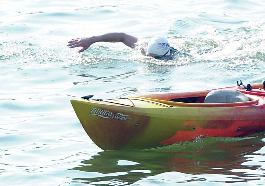 Michael Murphy of Croton-on-Hudson, N.Y., swims Long Island Sound during the Swim Across America event for the Greenwich-Stamford area at Cummings Point in Stamford, Saturday morning, June 22, 2013. Swim Across America, Inc., is an organization dedicated to raising money and awareness for cancer research, prevention and treatment, through swimming- related events. Photo: Bob Luckey / Greenwich Time