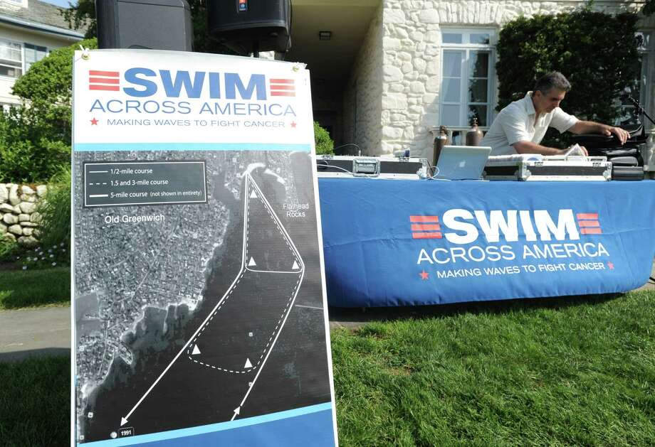 The Swim Across America event for the Greenwich-Stamford area at Cummings Point in Stamford, Saturday morning, June 22, 2013. Swim Across America, Inc., is an organization dedicated to raising money and awareness for cancer research, prevention and treatment, through swimming- related events. Photo: Bob Luckey / Greenwich Time