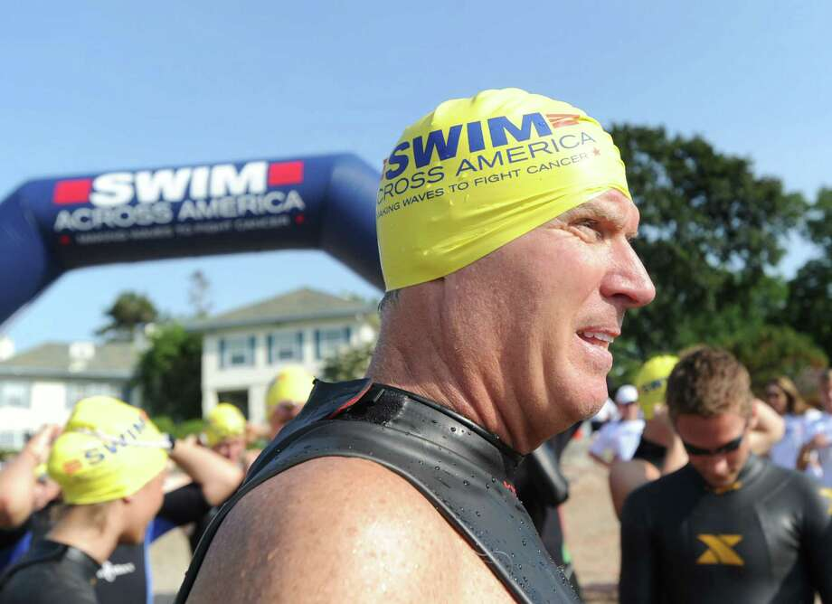 Jim O'Brien of Wilton during the Swim Across America event for the Greenwich-Stamford area at Cummings Point in Stamford, Saturday morning, June 22, 2013. Swim Across America, Inc., is an organization dedicated to raising money and awareness for cancer research, prevention and treatment, through swimming- related events. Photo: Bob Luckey / Greenwich Time