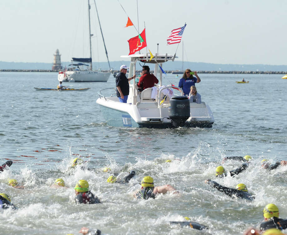 The Swim Across America event for the Greenwich-Stamford area in Long Island Sound off Cummings Point in Stamford, Saturday morning, June 22, 2013. Swim Across America, Inc., is an organization dedicated to raising money and awareness for cancer research, prevention and treatment, through swimming- related events. Photo: Bob Luckey / Greenwich Time