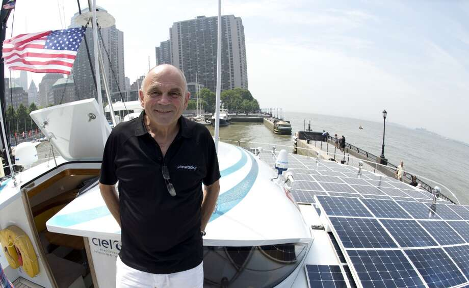 Gerard dAboville, captain of the worlds largest solar boat, Switzerlands MS Turanor PlanetSolar, stands on the boat's deck on June 18, 2013 at North Cove Marina in New York. The solar-powered boat runs exclusively on energy from the sun and eliminates the need for fueled electricity, allowing researchers to collect uncontaminated data along the Gulf Stream with high-tech instruments that track changes in ocean currents and climate. Solar panels cover more than 5,554 square feet (516 square meters) of the ships surface.  AFP PHOTO/Don EmmertDON EMMERT/AFP/Getty Images Photo: DON EMMERT, AFP/Getty Images