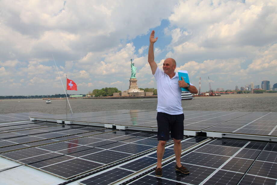 PlanetSolar Captain Gérard d'Aboville celebrates the boat's arrival in New York City in June 2013. Photo: Picasa, Anh-Dao LE / Anh-Dao LE