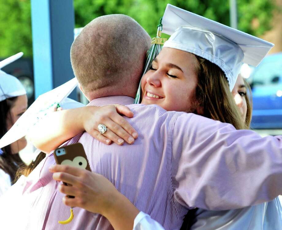 Elizabeth Di Domiziol hugs math teacher Eugene Hall as Newtown High School Class of 2013 graduation exercises take place at the O'Neill Center, on the campus of Western Connecticut State University, in Danbury, Conn. Saturday, June 22, 2013. Photo: Michael Duffy / The News-Times