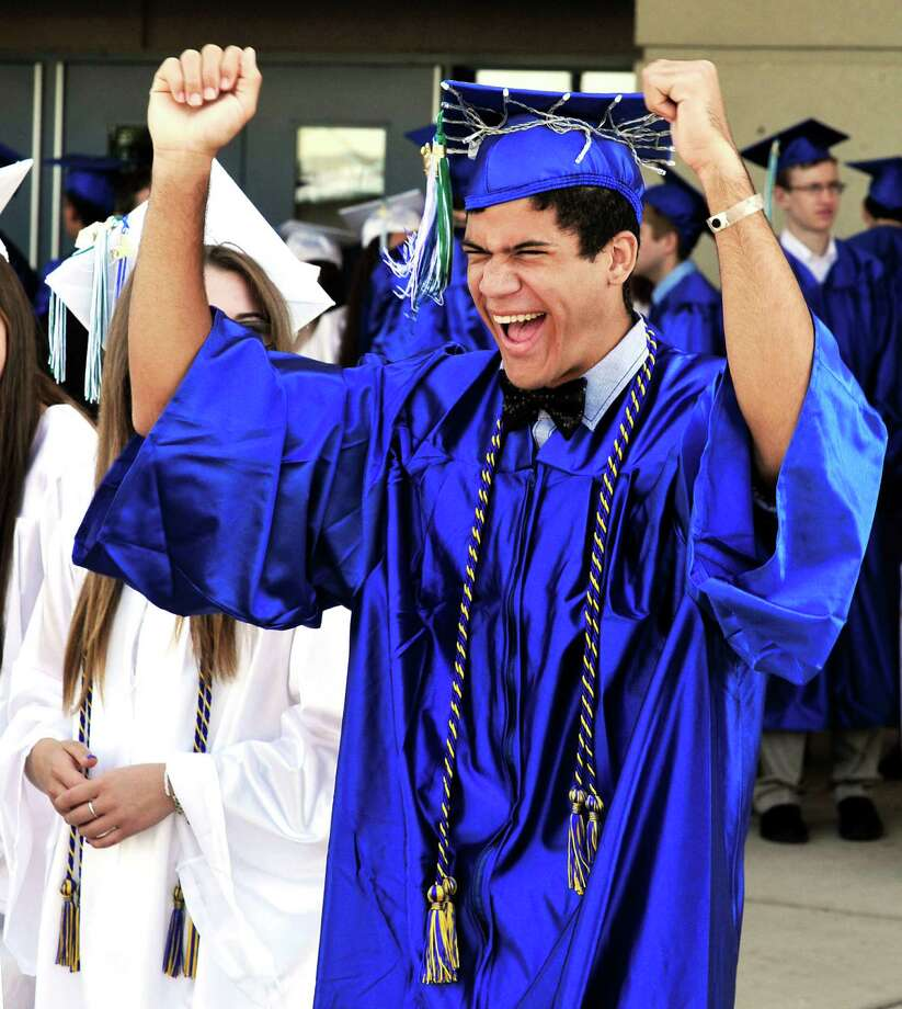 Brandon Ghent celebrates as Newtown High School Class of 2013 graduation exercises take place at the O'Neill Center, on the campus of Western Connecticut State University, in Danbury, Conn. Saturday, June 22, 2013. Photo: Michael Duffy / The News-Times