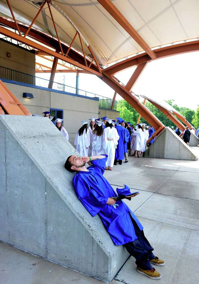 Jesse Dantin relaxes before Newtown High School Class of 2013 graduation exercises take place at the O'Neill Center, on the campus of Western Connecticut State University, in Danbury, Conn. Saturday, June 22, 2013. Photo: Michael Duffy / The News-Times