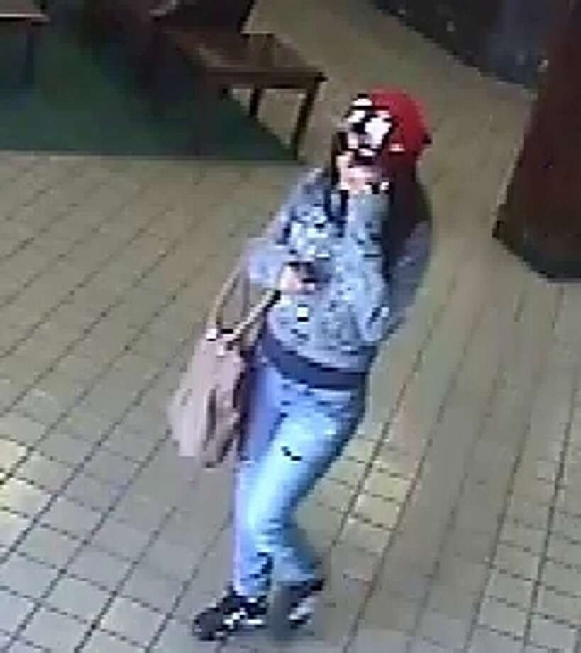 "Dressed in denim pants and jacket, this woman who allegedly robbed a Comerica bank on June 21 has been named the ""Denim Diva"" by the FBI. Photo: FBI"