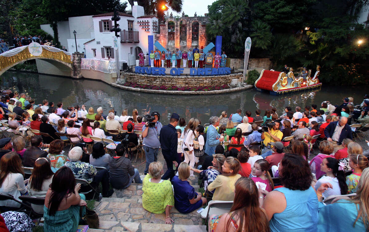 The crowd at Arneson Theatre listens to speakers during the Texas Cavalier's River Parade.