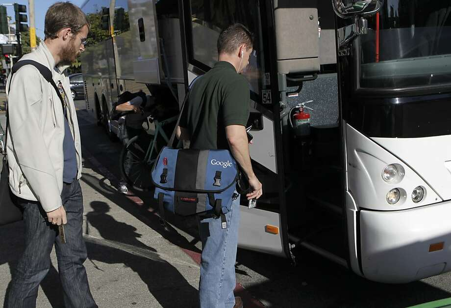 Google employees board a private shuttle bus at 18th and Dolores streets in San Francisco, Calif. that will transport them to Silicon Valley on Friday, June 14, 2013. Photo: Paul Chinn, The Chronicle