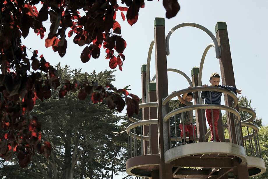 Two boys play at Mountain Lake Park Playground in the Richmond District. Photo: Carlos Avila Gonzalez, The Chronicle