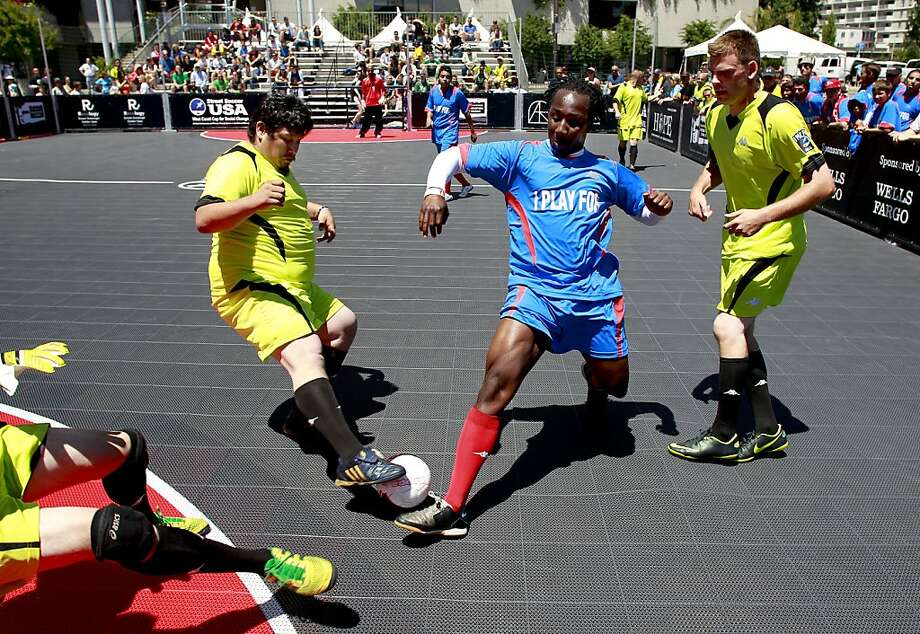 Ablaza Grant of Street Soccer San Francisco dribbles through Sacramento Mohawks defenders in the first West Coast tournament. Photo: Michael Macor, The Chronicle