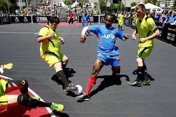 Ablaza Grant of the Street Soccer San Francisco team, dribbles a few defenders of the Sacramento Mohawks  during the first annual USA West Coast Cup at Justin Herman Plaza in San Francisco, Calif.  Street Soccer USA uses the power of soccer to help homeless men and women dramatically transform their lives. We utilize the power of sports, in this case soccer, to promote player development not merely on the field, but in every aspect of life.
