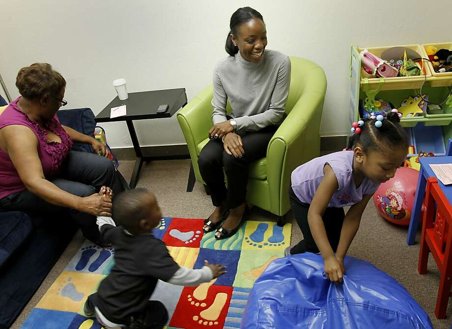 Dr. Nadine Burke Harris (center) watches as grandmother Leona Hunter and her two grandchildren play in the Center for Youth Wellness in the Bayview. Photo: Brant Ward, The Chronicle
